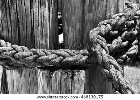Weathered Nautical Rope tied around a Wooden Post
