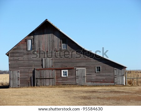 weathered old farm building - stock photo