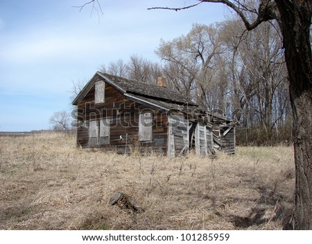 weathered old farm buildings - stock photo