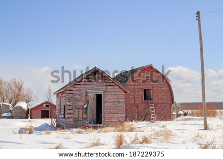 Weathered old red barn and shed