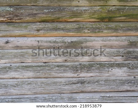Weathered old rough wood log cabin wall surface background