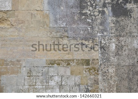 Weathered old stone block wall texture background - stock photo