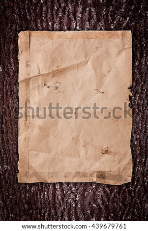 Weathered paper on a wooden background