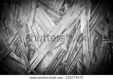 Weathered pressed wood texture. Aged photo. Black and white. Shadowed angles. - stock photo