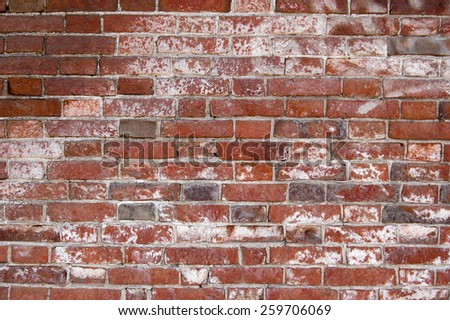 Weathered red brick wall background. - stock photo