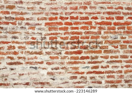 weathered red brick wall, texture on exterior of old castle - stock photo