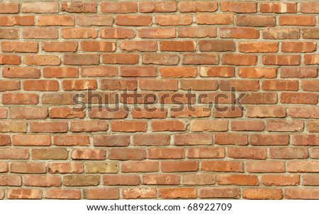 Weathered red brick wall texture seamlessly tileable - stock photo