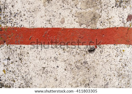 weathered red color marking line on concrete surface background - stock photo