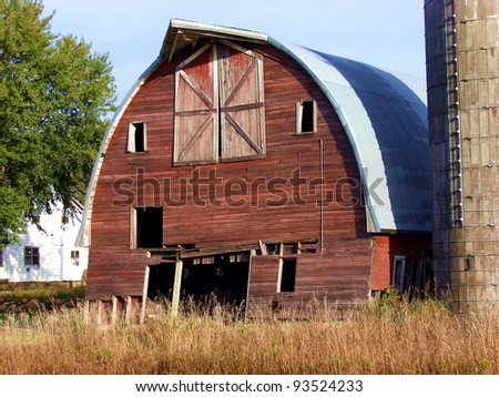 weathered red farm buildings barns