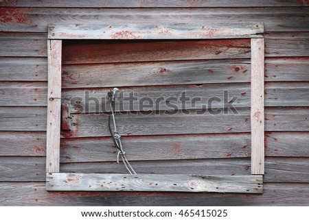 Weathered rustic closed barn window with room for copy