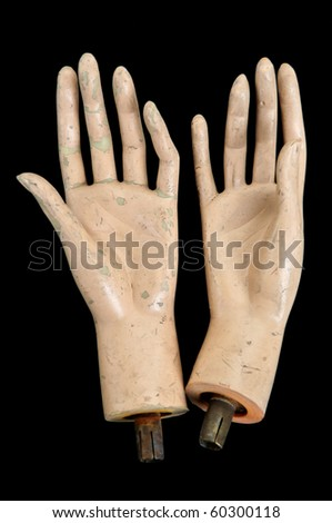 Weathered severed hands of plastic mannequin doll. - stock photo