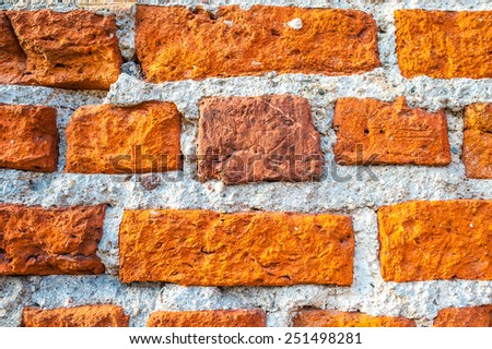Weathered stained old brick wall background - stock photo