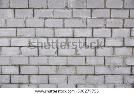 Weathered stained white brick wall texture