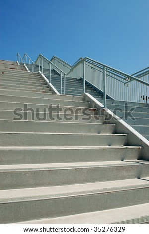 Weathered stair steps and railing; Anaheim Convention Center; Anaheim, California - stock photo