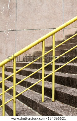 Weathered stair steps & Yellow railing