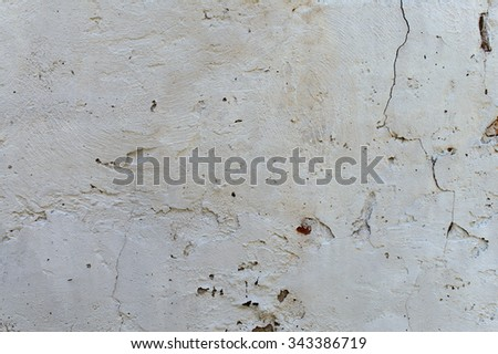 weathered stucco brick wall background - stock photo
