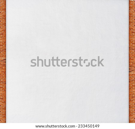 weathered stucco wall,  red brick frame background  - stock photo