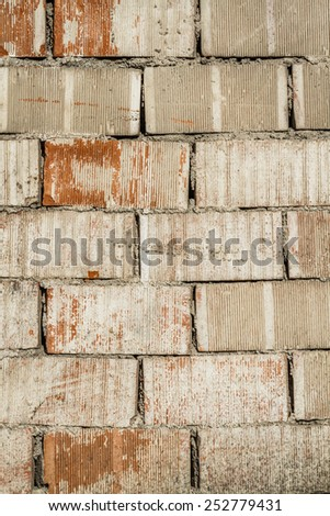 Weathered texture of  old red and painted white brick wall background - stock photo