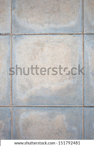 Weathered tiled concrete paving - stock photo