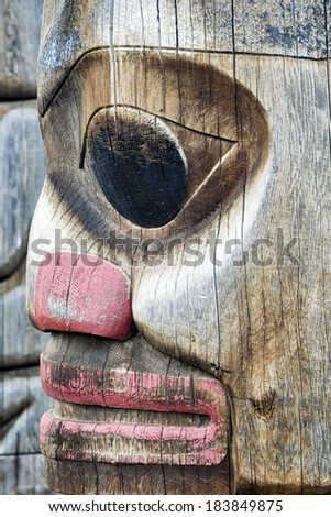 weathered totem face - stock photo