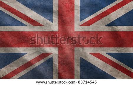 Weathered Union Jack UK flag grunge rugged condition waving - stock photo