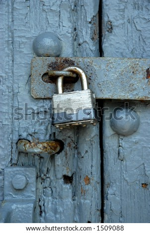 Weathered Vintage Padlocked Door - stock photo