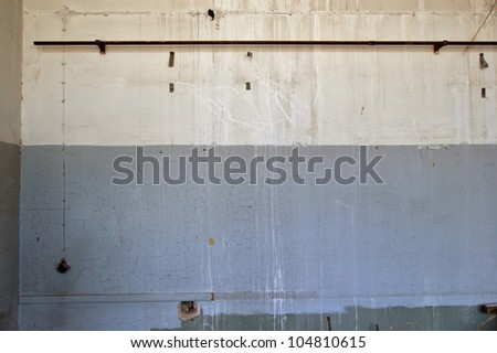Weathered wall in abandoned industrial interior. Background texture. - stock photo