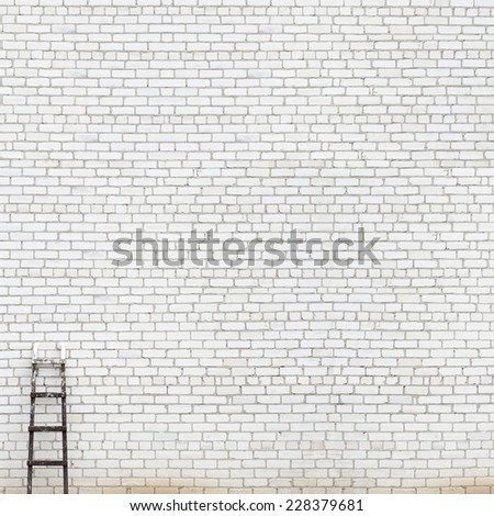 weathered white brick wall with wooden ladder background - stock photo