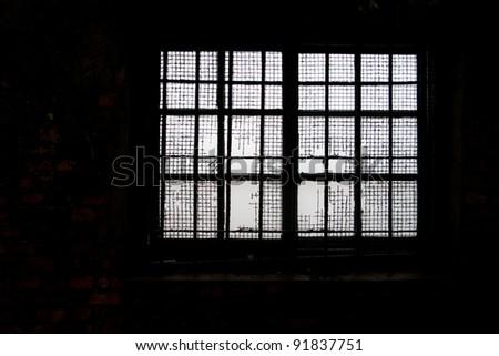 weathered window of wood and iron - stock photo