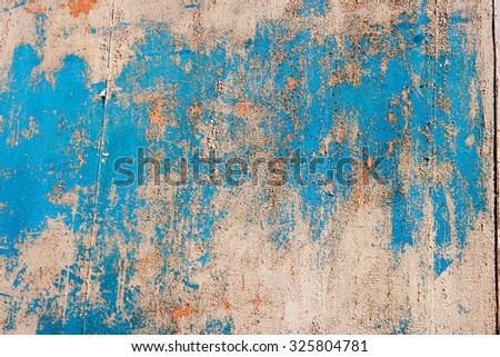 Weathered wood panel half painted in blue , frame for design - stock photo