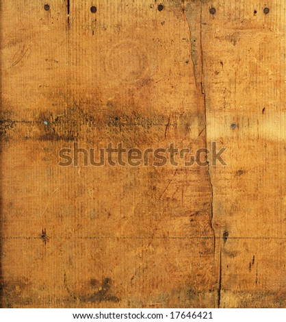 Weathered wood with rusty nails and cracks for background texture. - stock photo