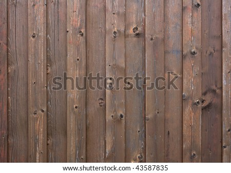 weathered wooden outside wall of traditional farm building - stock photo