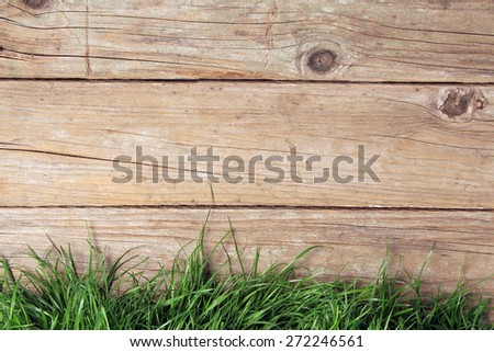 weathered wooden plank fence and grass.  - stock photo