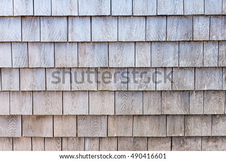 weathered wooden shingles on the side of a fishing shack