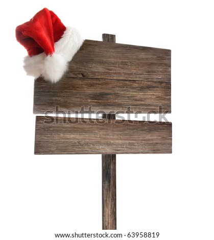 Weathered wooden sign with Santa hat on white background - stock photo