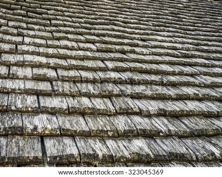 Weathered wooden tiled roof background - stock photo