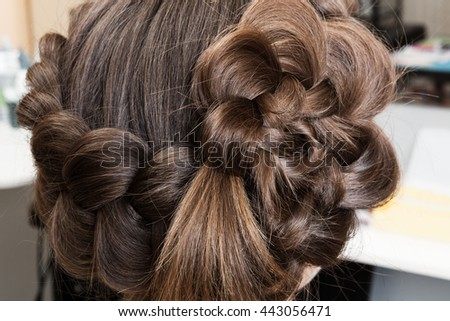 weave beautiful braids in a hairdressing salon - stock photo