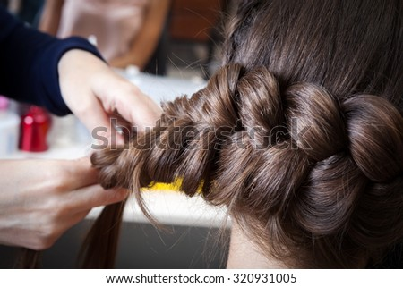 weave braids in the hairdressing salon - stock photo