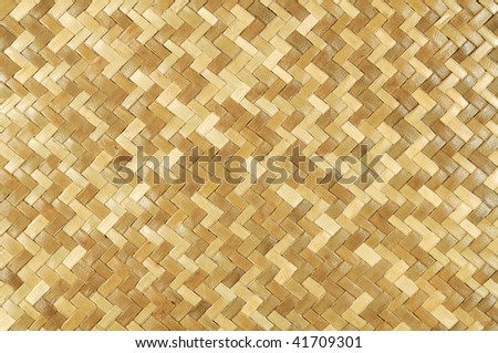 Weaved rattan mat for background use. - stock photo
