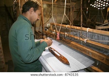 weaver working handloom at workshop, delhi, india - stock photo