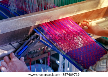 weaves with an old loom, farabic fashionable textile handcraft rug - stock photo