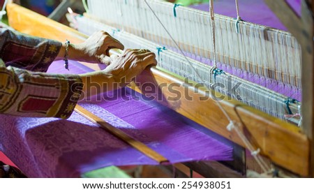 Weaving cloth for using in local village - stock photo
