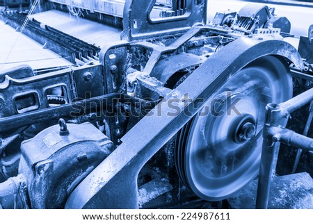 weaving factory with old lathe machine - stock photo