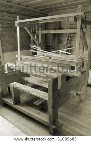 Weaving loom in the rural house in Latvia. - stock photo