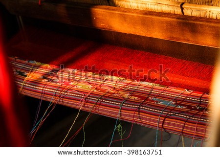 Weaving Loom,loom,Thai style traditional hand-weaving loom being used to make cloth - stock photo