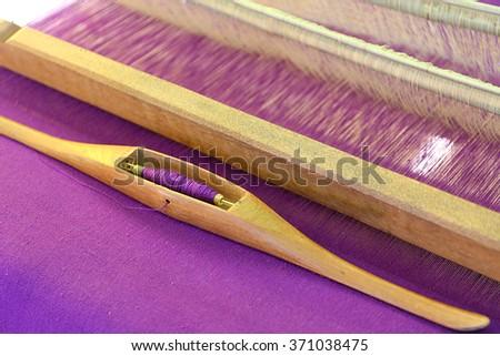 Weaving shuttle on the warp - stock photo