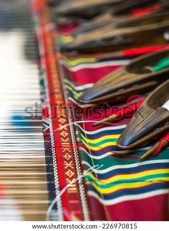 Weaving shuttles and colorful textile with pattern