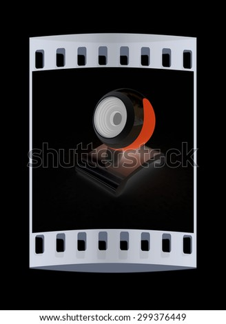 Web-cam on a black background. The film strip - stock photo