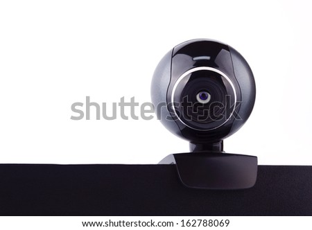 Web camera with the blue eye, making it's surveillance