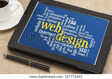 web design word cloud on a  digital tablet with a cup of coffee - stock photo